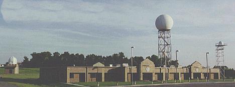 Building and surrounding radar towers