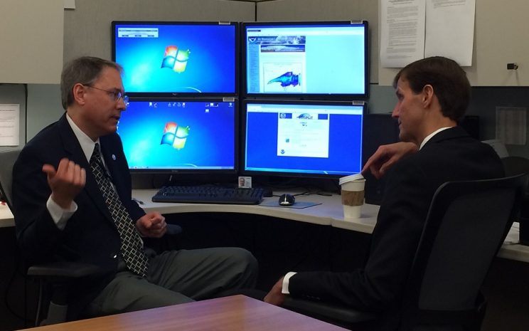 Glenn Rolph and RDML Gallaudet viewing and discussing HYSPLIT simulations