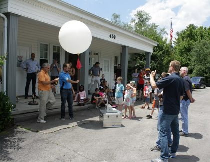 Holding a radiosonde (balloon) just before launch