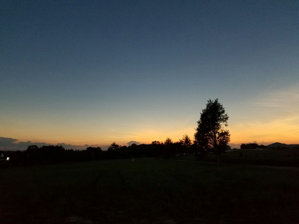 Landscape in shadow during eclipse totality