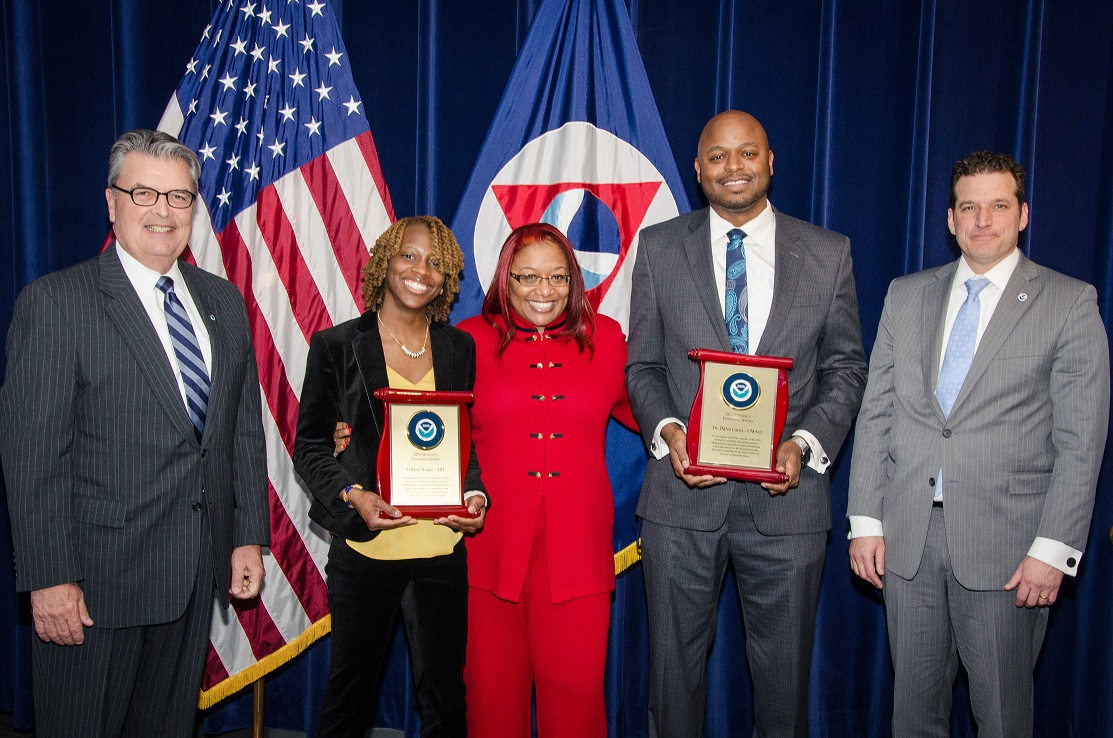Tiffany and another honoree posing with their awards, along with three members of NOAA management.
