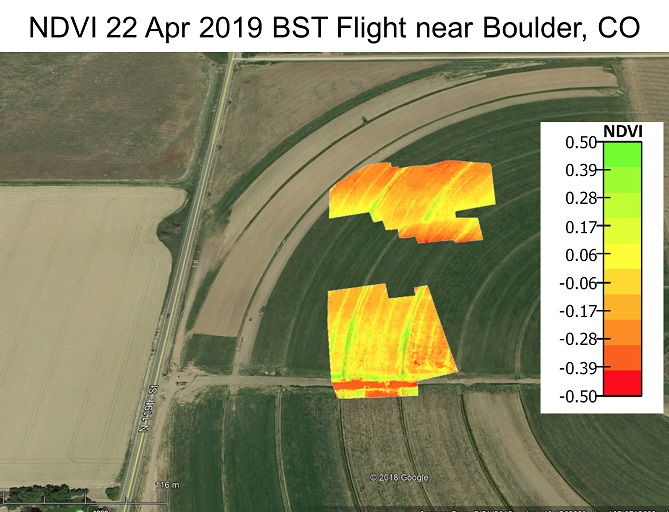 Aerial imagery of a mostly brown and green field with two yellow/orange areas taken 4/22/19 near Boulder, CO
