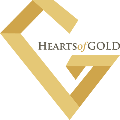 Hearts of Gold logo: large gold G slanted from left to right with the words Hearts of Gold inside