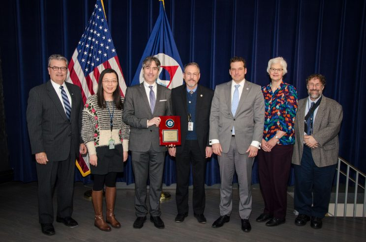 The five authors with their award, along with two senior NOAA managers. Rolph is at the center of the seven-person group.