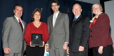 Betty Wells receiving her OAR Employee of the Year Award from Craig McLean