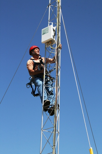 ARL scientist installing equipment on tower for California air study. Photo Credit: NOAA, May 2010